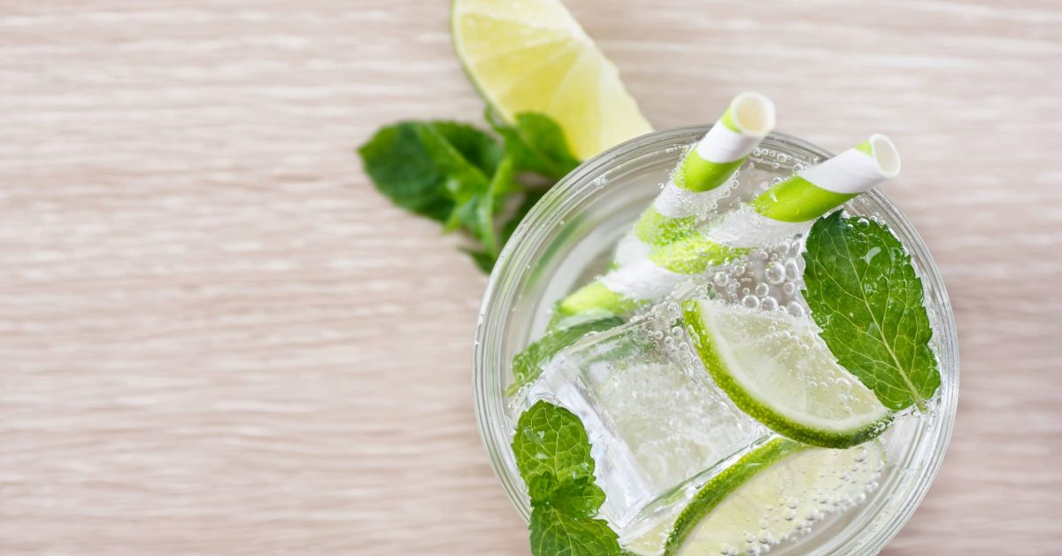 Flat lay lime mint soda on wood. Detox water. Mojito. Summer refreshment concept. Text space